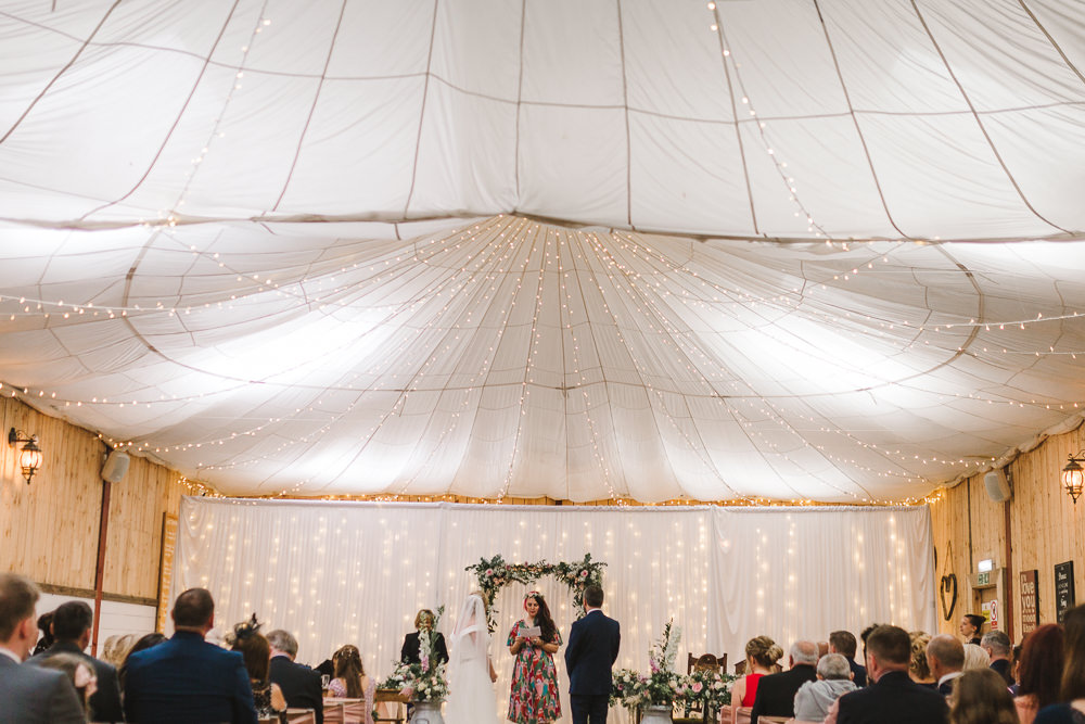 Ceremony Room Drapes Fairy Lights Ceiling Flowers Aisle Arch Floral Pink Greenery Wellbeing Farm Wedding Anna Wood Photography