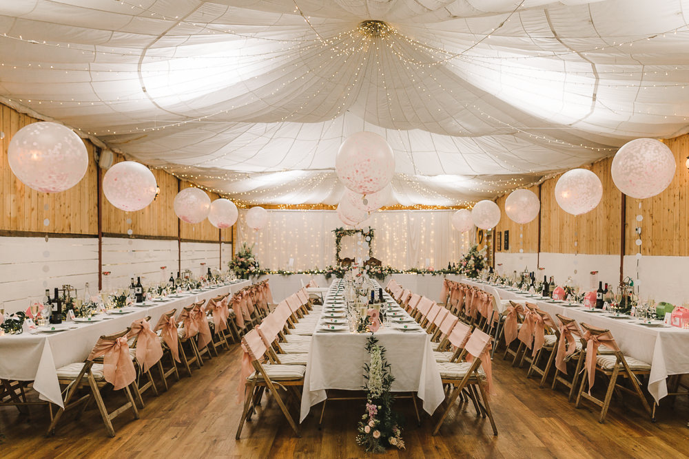 Reception Venue Room Drapes Fairy Lights Ceiling Flowers Aisle Arch Floral Pink Greenery Giant Balloons Wellbeing Farm Wedding Anna Wood Photography