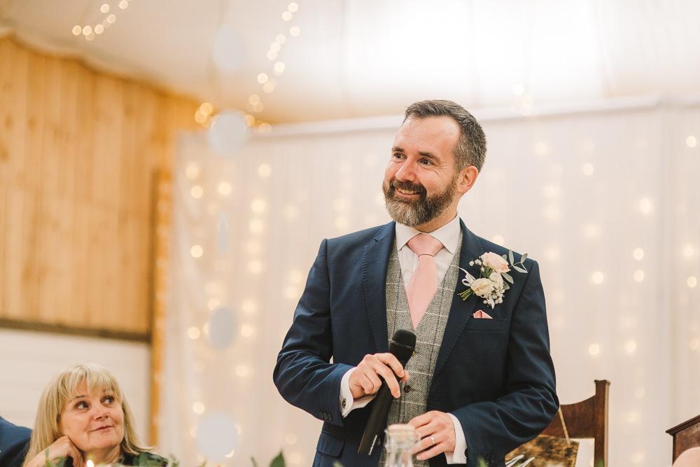 Groom Groomsmen Suit Navy Pink Tie Grey Waistcoat Wellbeing Farm Wedding Anna Wood Photography