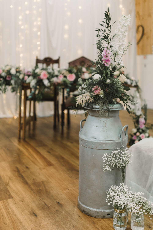 Milk Churn Flowers Pink Greenery Aisle Ceremony Wellbeing Farm Wedding Anna Wood Photography