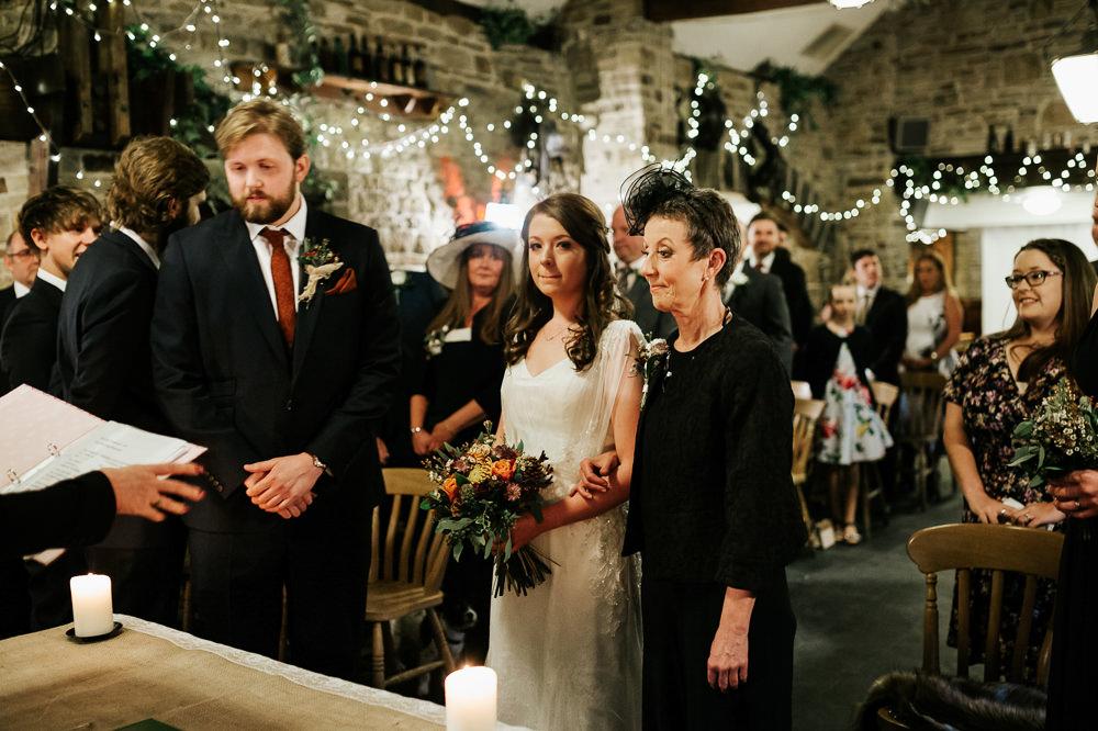 Bride Bridal Dress Cape Sleeve V Neck Lace Embellished Groom Burnt Orange Tie Black Suit Cubley Hall Wedding Photography by Charli