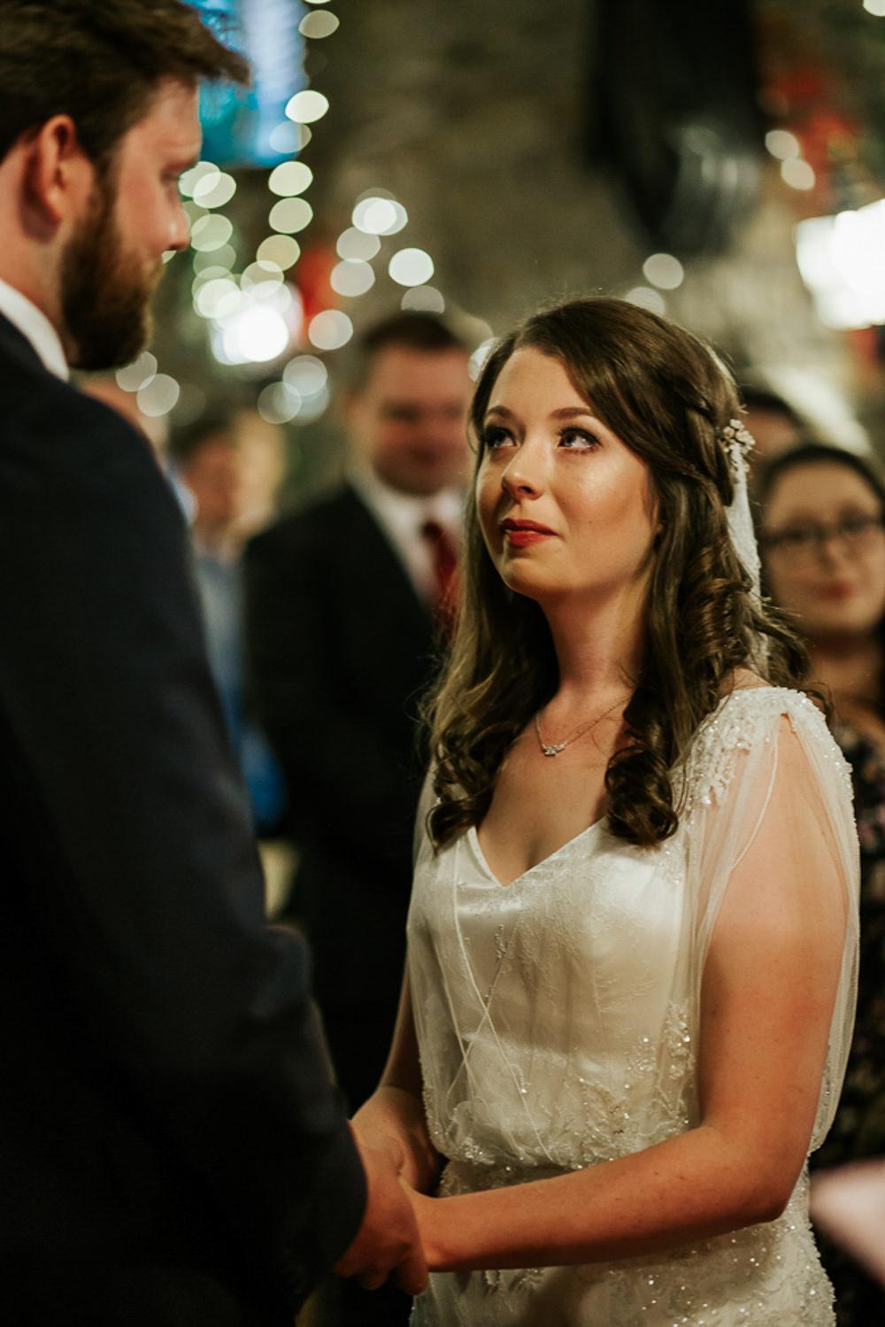 Bride Bridal Dress Cape Sleeve V Neck Lace Embellished Groom Burnt Orange Tie Black Suit Veil Cubley Hall Wedding Photography by Charli