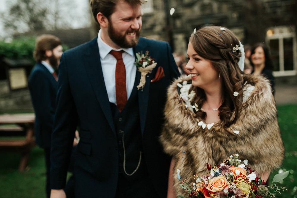 Bride Bridal Dress Cape Sleeve V Neck Lace Embellished Groom Burnt Orange Tie Black Suit Fur Stole Cape Confetti Cubley Hall Wedding Photography by Charli