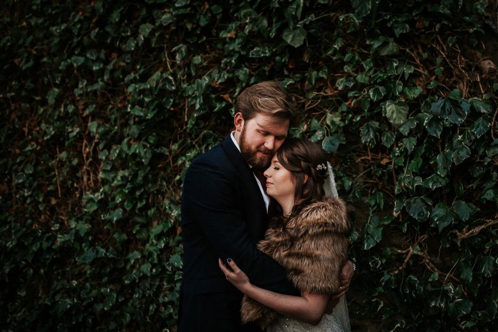 Bride Bridal Dress Cape Sleeve V Neck Lace Embellished Groom Burnt Orange Tie Black Suit Fur Stole Cape Cubley Hall Wedding Photography by Charli