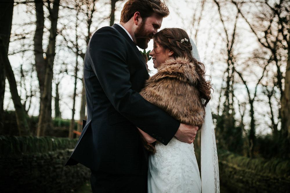 Bride Bridal Dress Cape Sleeve V Neck Lace Embellished Groom Burnt Orange Tie Black Suit Fur Stole Cape Veil Cubley Hall Wedding Photography by Charli