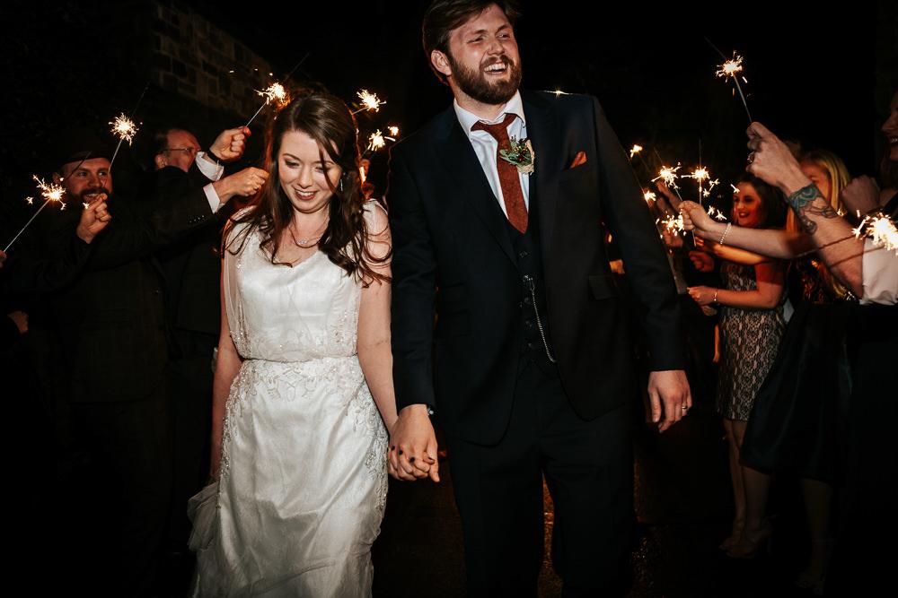 Bride Bridal Dress Cape Sleeve V Neck Lace Embellished Groom Burnt Orange Tie Black Suit Sparklers Cubley Hall Wedding Photography by Charli
