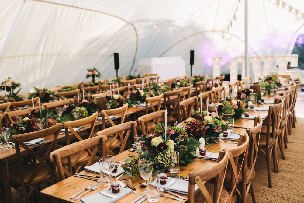 Wooden Tables Cross Back Chairs Greenery Flowers Stretch Tent Floral Farm Wedding Jessica O'Shaughnessy Photography