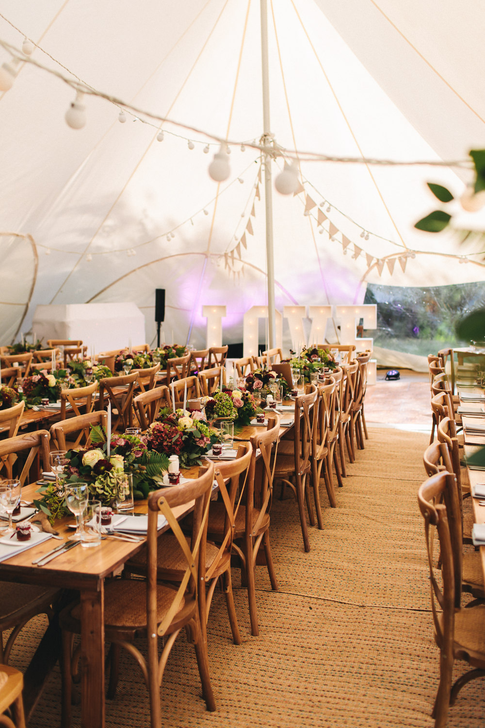 Stretch Tent Bunting Festoon Lighting Wooden Tables Cross Back Chairs Greenery Flowers Floral Farm Wedding Jessica O'Shaughnessy Photography