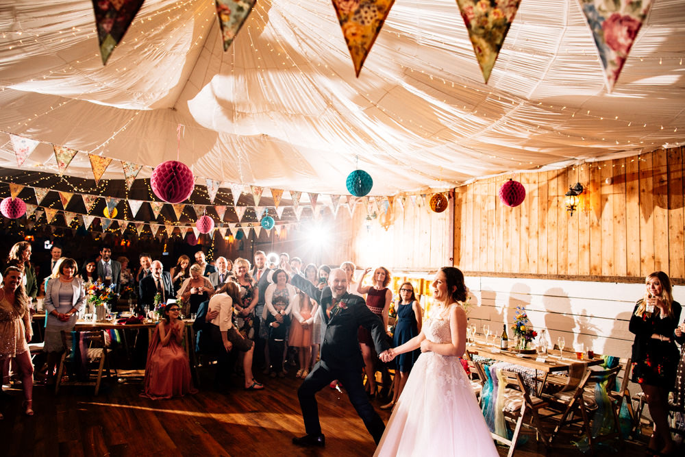 Bride Bridal Lace Tulle Full Skirt Sweetheart Illusion Navy Suit Orange Tie Groom Multicoloured Paper Lanterns Bunting Parachute Ceiling Fun Quirky Colourful Wedding Fairclough Studios