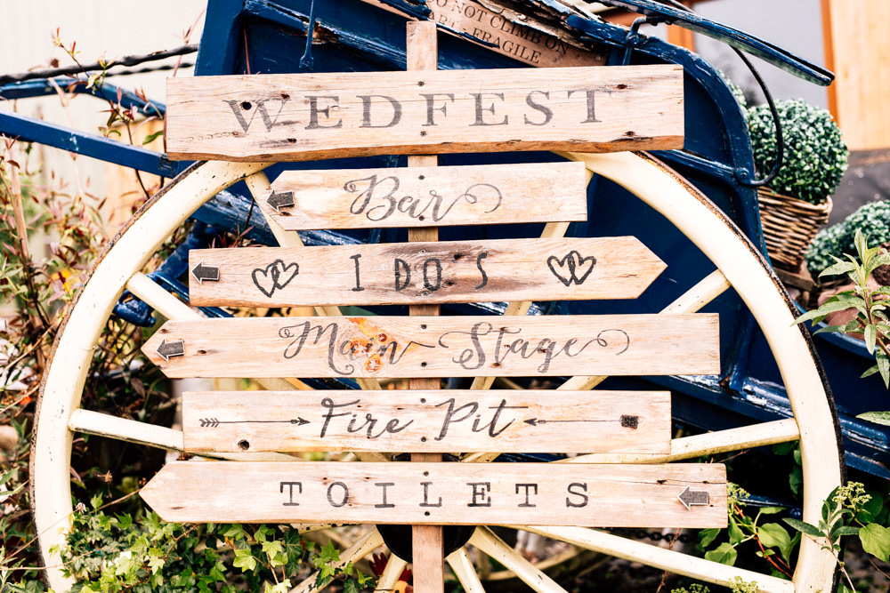 Wooden Direction Sign Rustic Wheel Wedfest Fun Quirky Colourful Wedding Fairclough Studios