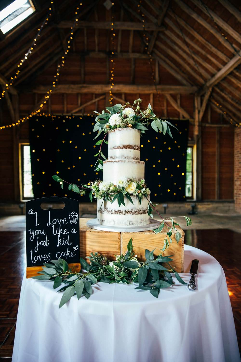 Semi Naked Cake Table Greenery Foliage Flowers Wooden Box Crate Long Barn Wedding Three Flowers Photography