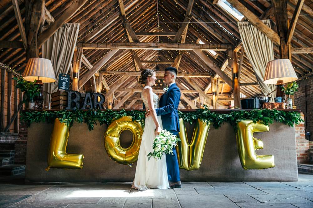 LOVE Balloons Gold Long Barn Wedding Three Flowers Photography
