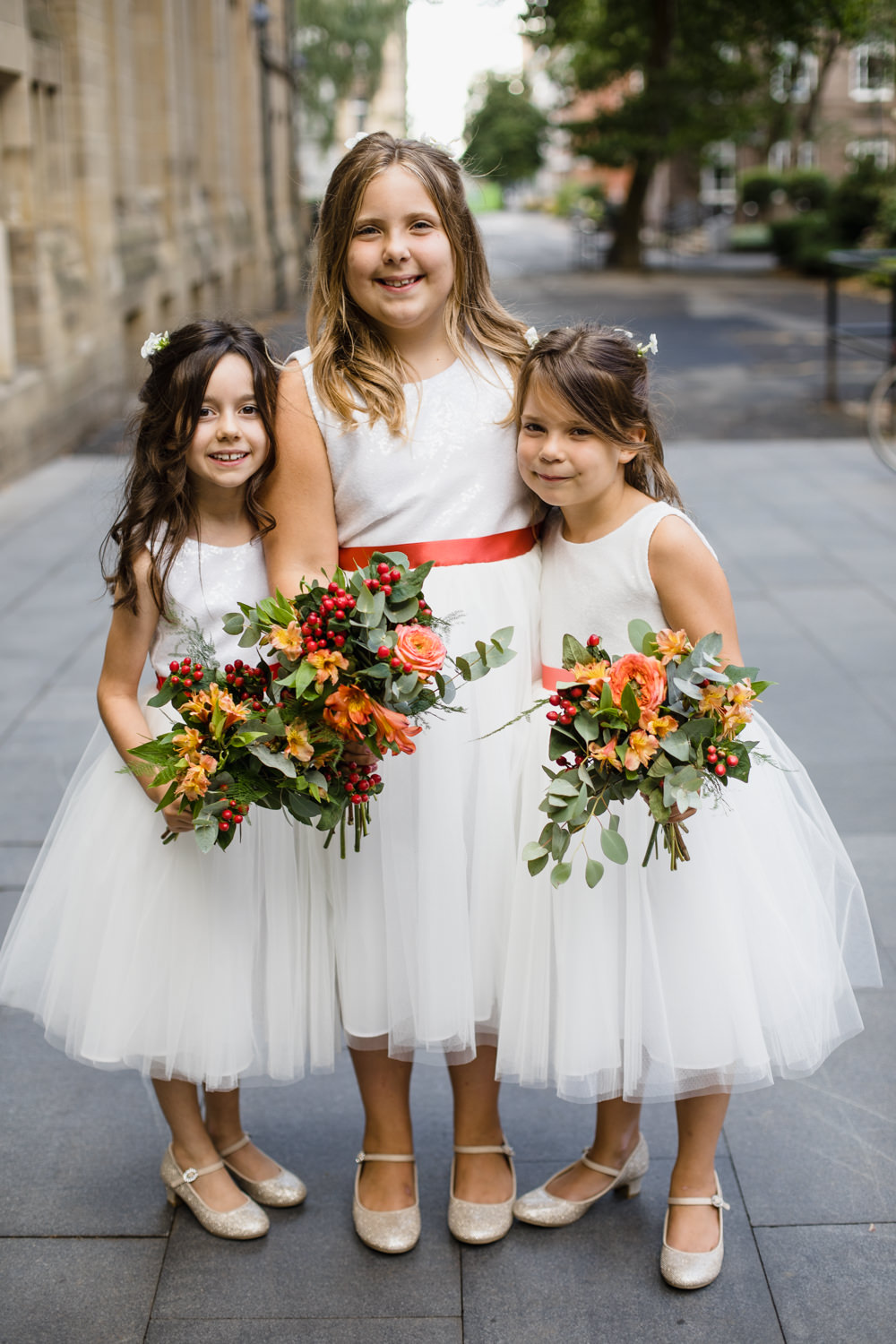 Flower Girls Orange Red Sash Bouquet Peach Rose Berry Manchester Museum Wedding Chris Barber Photography