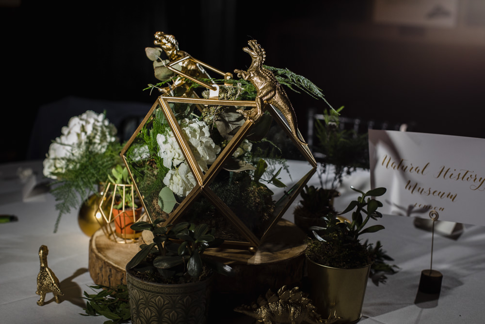 Table Centre Gold Dinosaur Terrarium Greenery Wood Slice Manchester Museum Wedding Chris Barber Photography