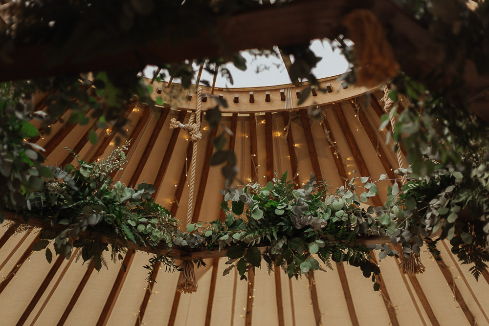 Hanging Hoop Suspended Flowers Greenery Foliage Eucalyptus Riverside Weddings Oxfordshire Yurt Luis Calow Photographer