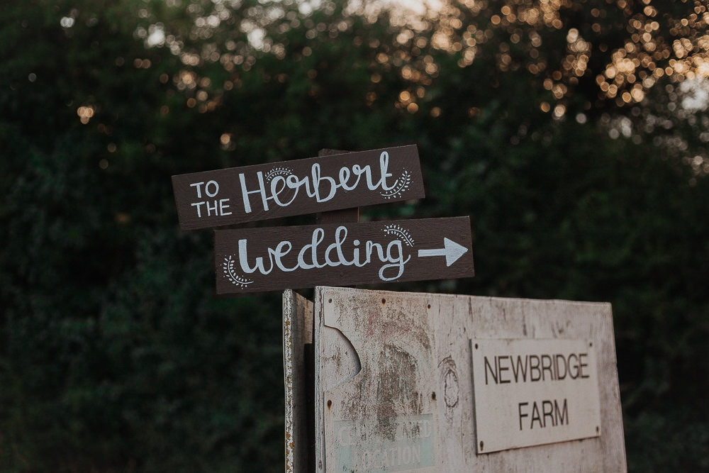 Wooden Painted Rustic Sign Post Signage Riverside Weddings Oxfordshire Yurt Luis Calow Photographer
