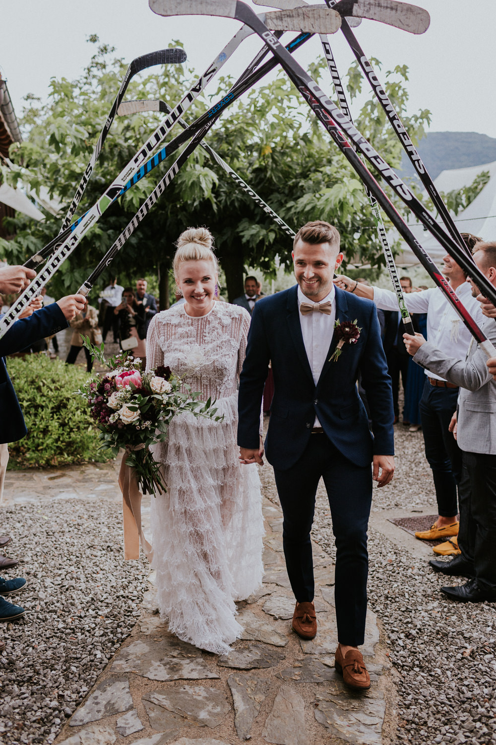 Hockey Stick Arch Bride Groom Slovenia Wedding Bohemian Maja Tsolo Photography