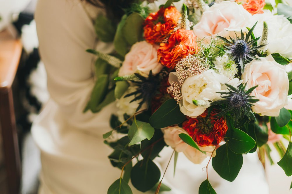 Bouquet Flowers Bride Bridl Blush Orange Foliage Greenery Rose Thistle Peony Victoria Warehouse Wedding Manchester Kate McCarthy Photography