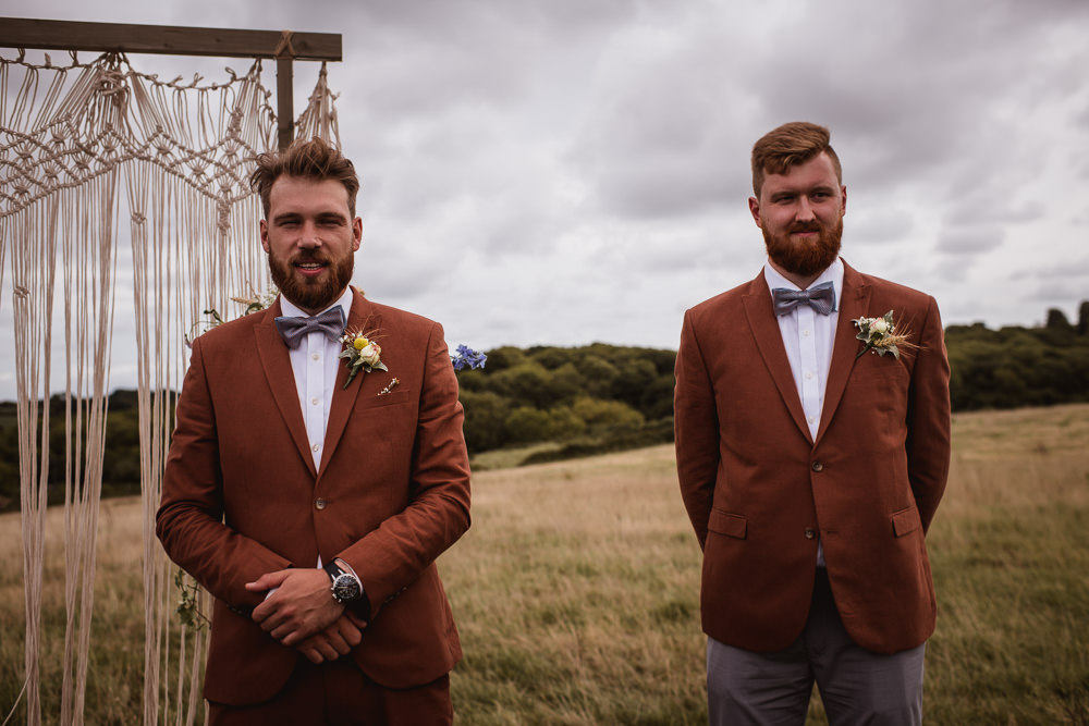 Tan Suit Groom Groomsman Bow Tie Macrame Ceremony Backdrop Wilkswood Farm Wedding Robin Goodlad Photography