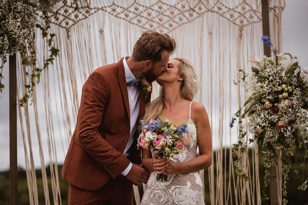 Bride Bridal Grace Loves Lace Rosa Sleeveless Dress Gown Boho Macrame Floral Flowers Gypsophila Ceremony Backdrop Tan Suit Bow Tie Groom Wilkswood Farm Wedding Robin Goodlad Photography