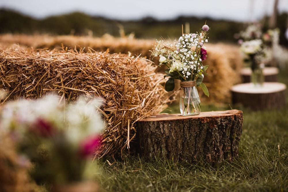 Aisle Ceremony Tree Trunks Jar Flowers Floral Straw Bale Wilkswood Farm Wedding Robin Goodlad Photography