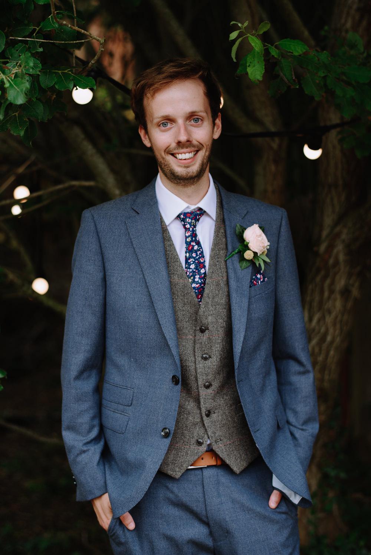 Groom Navy Suit Grey Waistcoat Floral Tie Rose Buttonhole Boho Festival Wedding Matt Bowen Photography