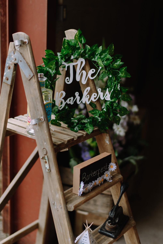 Wooden Ladder Decor Sign Greenery Foliage Boho Festival Wedding Matt Bowen Photography