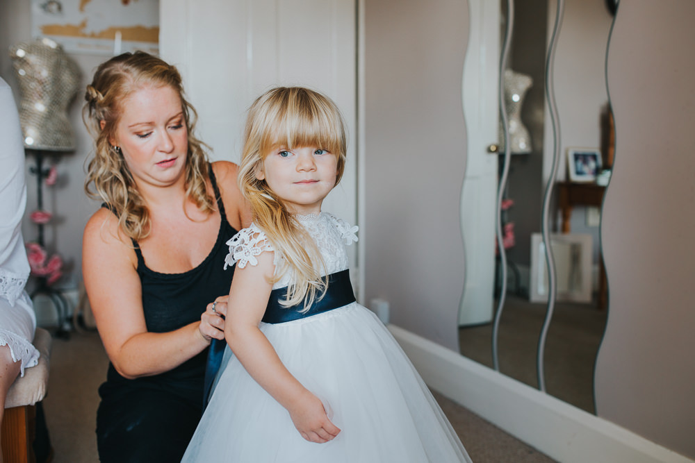 Flower Girl Dress Navy Sash Colourful Tipi Wedding Charlotte Razzell Photography
