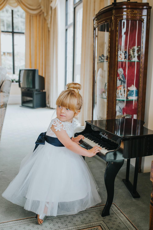 Flower Girl Dress Navy Sash Bun Hair Colourful Tipi Wedding Charlotte Razzell Photography