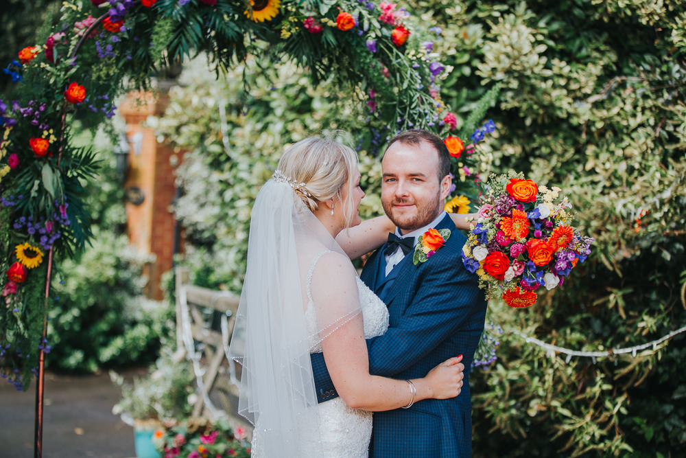 Flower Arch Backdrop Greenery Foliage Flowers Sunflowers Rose Colourful Tipi Wedding Charlotte Razzell Photography