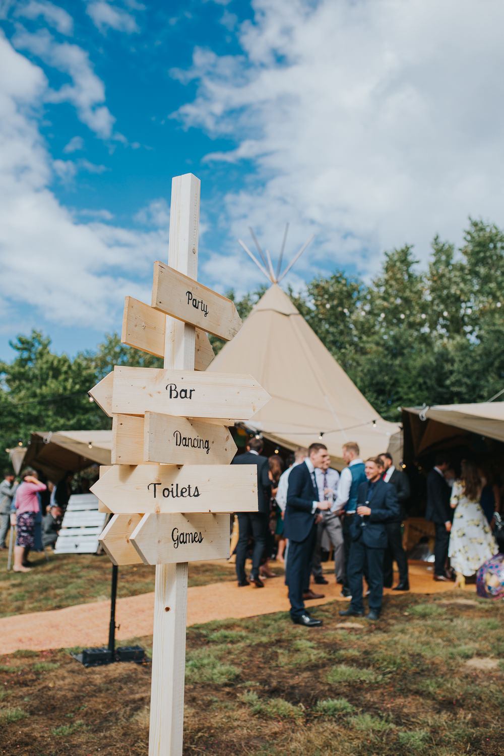 Wooden Sign Post Directions Colourful Tipi Wedding Charlotte Razzell Photography