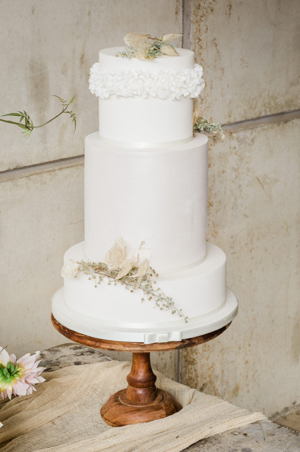 Cake Iced Ruffle White Flowers Wooden Stand Fine Art Farm Wedding Ideas Seyi Rochelle Photography