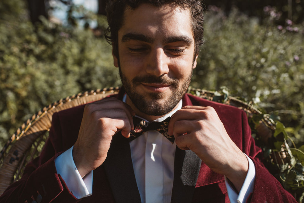 Groom Suit Red Burgundy Velvet Jacket Bow Tie French Alps Folk Boho Mountain Wedding Ideas Katja & Simon Photography