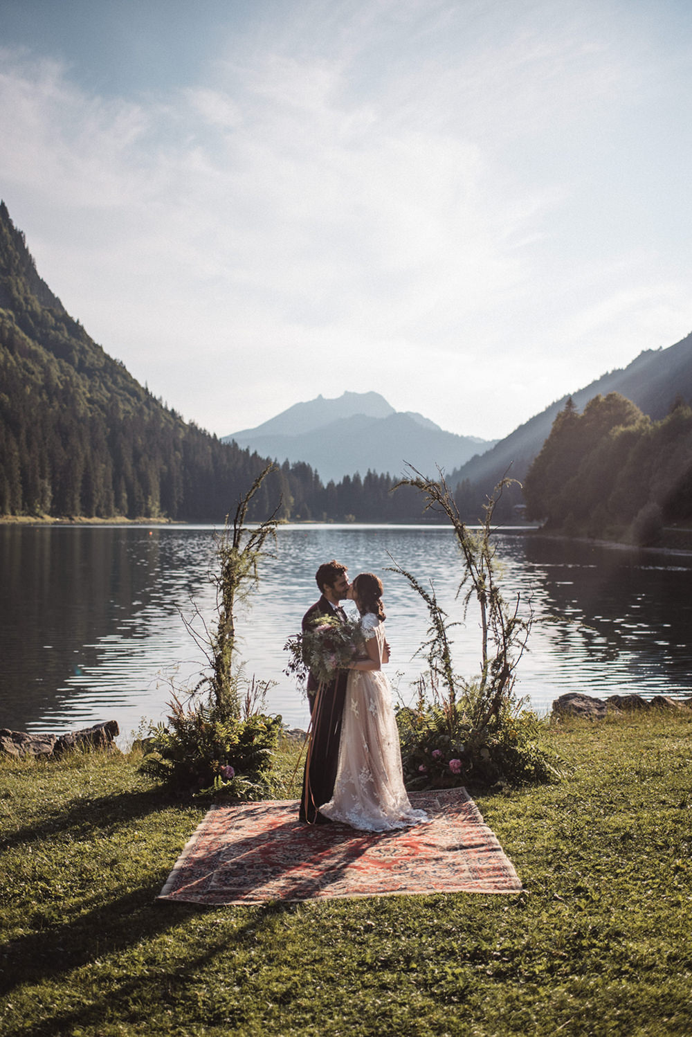 Backdrop Flowers Ceremony Persian Rug Aisle Branches Lake Outdoor French Alps Folk Boho Mountain Wedding Ideas Katja & Simon Photography