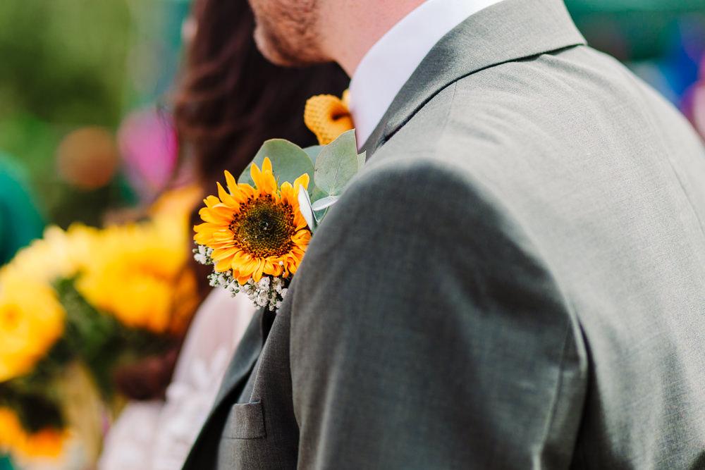 Sunflower Buttonhole Groom Fun Colourful Festival Camp Wedding Rachel Burt Photography