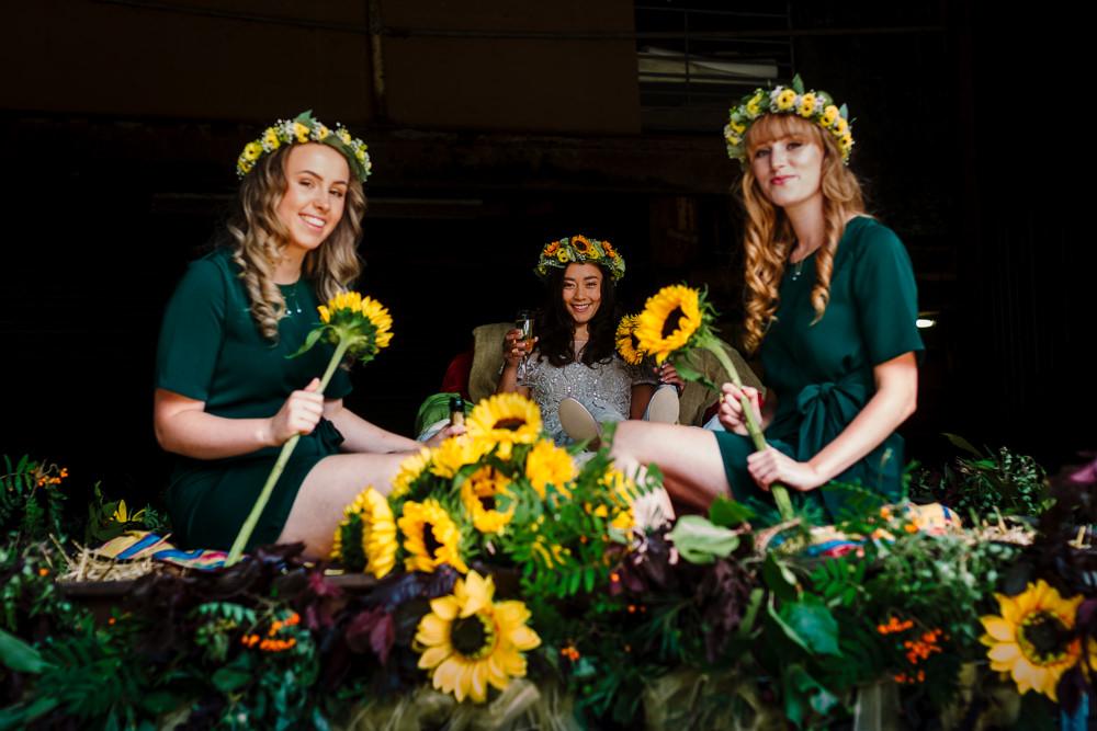 Bridesmaids Green Dresses Sunflowers Flower Crown Bouquets Fun Colourful Festival Camp Wedding Rachel Burt Photography