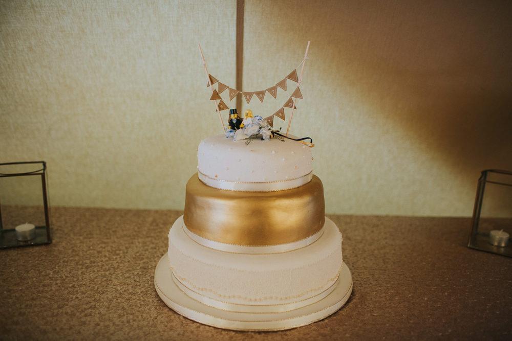 White Gold Cake Bunting Topper Minnehaha Events Wedding Lisa Webb Photography
