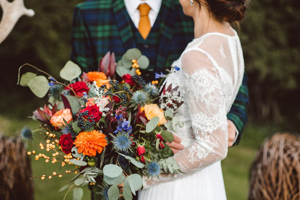 Bouquet Flowers Bride Bridal Blue Delphiniums Thistles Grey Eucalyptus Orange Roses Dahlias Red Amaranthus Ribbons Rustic Christmas Wedding Ideas Dhw Photography