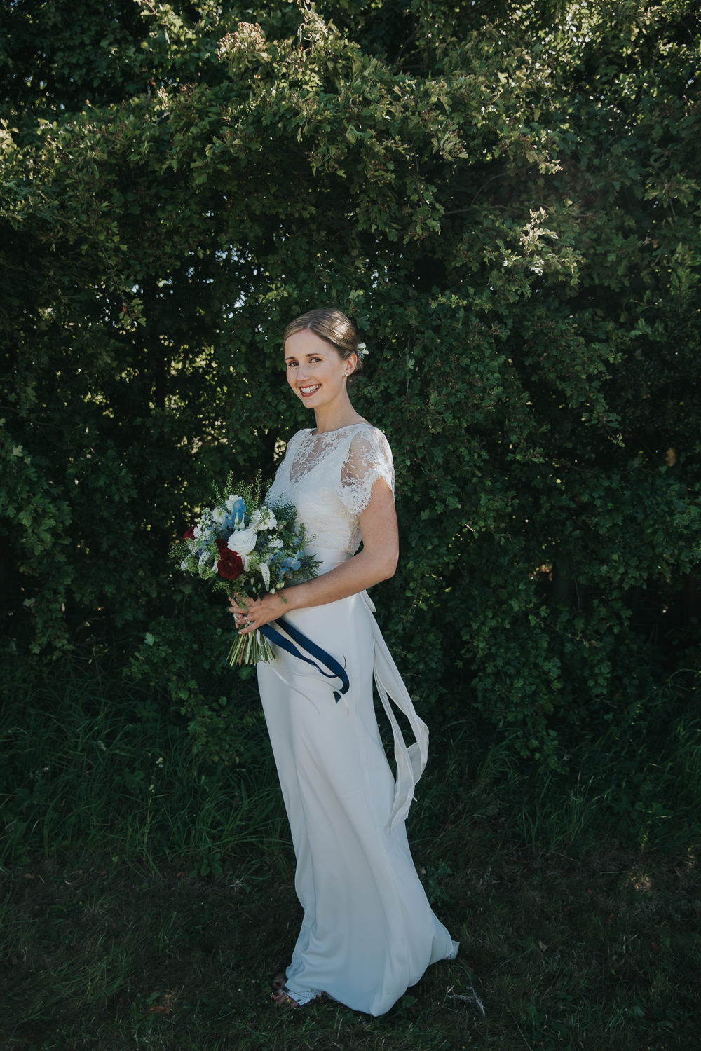 Bride Bridal Fitted Dress Silk Lace Overlay Blue Red Stocks Flowers Bouquet Strawberry Barn Wedding Jen Owens Images