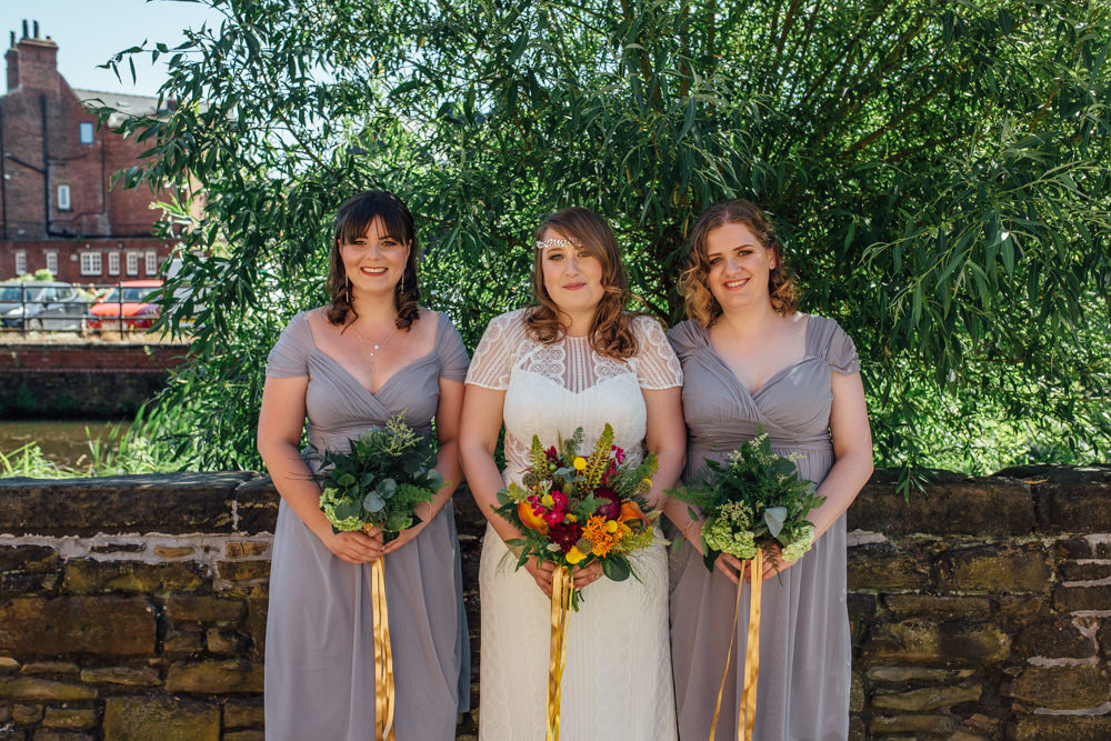 Bride Bridal High Neck Short Sleeve Lace Dress Crystal Headband Headpiece Sweetheart Neckline Waistcoat Slate Grey Bridesmaids Multicoloured Bouquet Ribbon The Chimney House Wedding Ellie Grace Photography