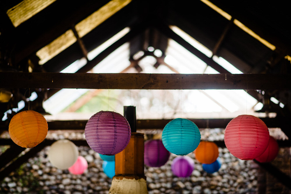 Barn Hanging Paper Lanterns Multicolour West Lexham Wedding James Powell Photography