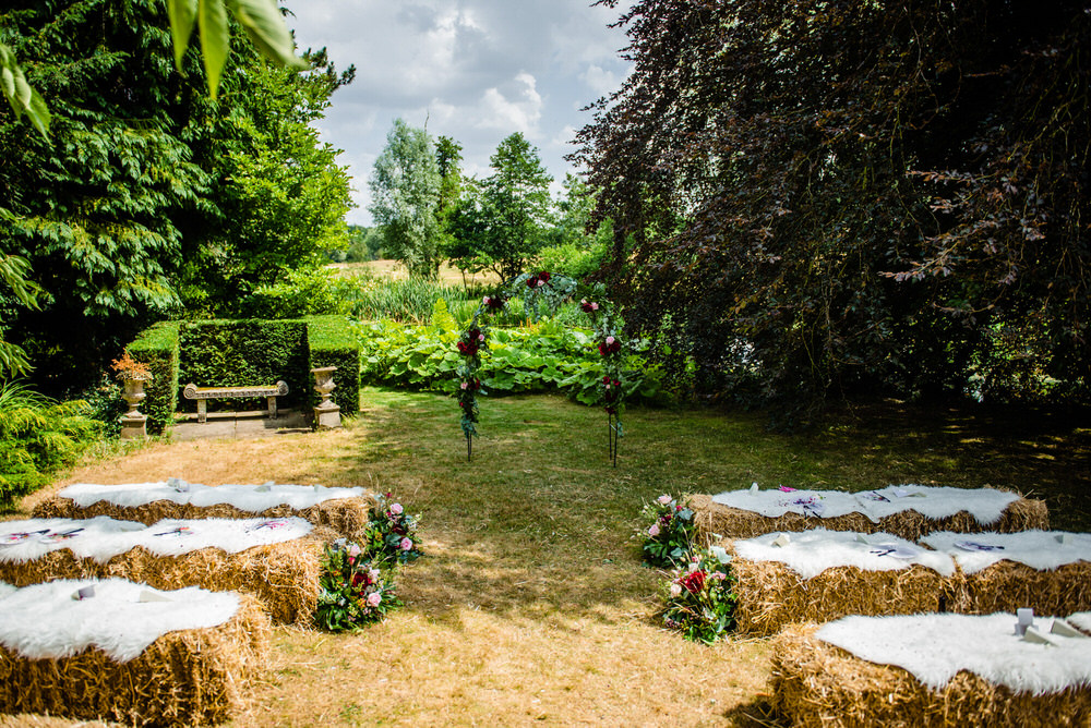 Hay Bales Seating Outdoor Ceremony Flower Aisle Arch Backdrop West Lexham Wedding James Powell Photography