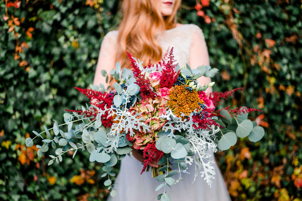 Bouquet Flowers Bride Bridal Red ORange Greenery Foliage Autumn Berries Hydrangea Eucalyptus Astilbe Autumnal Fairytale Wedding Ideas Miriam Peuser Photography