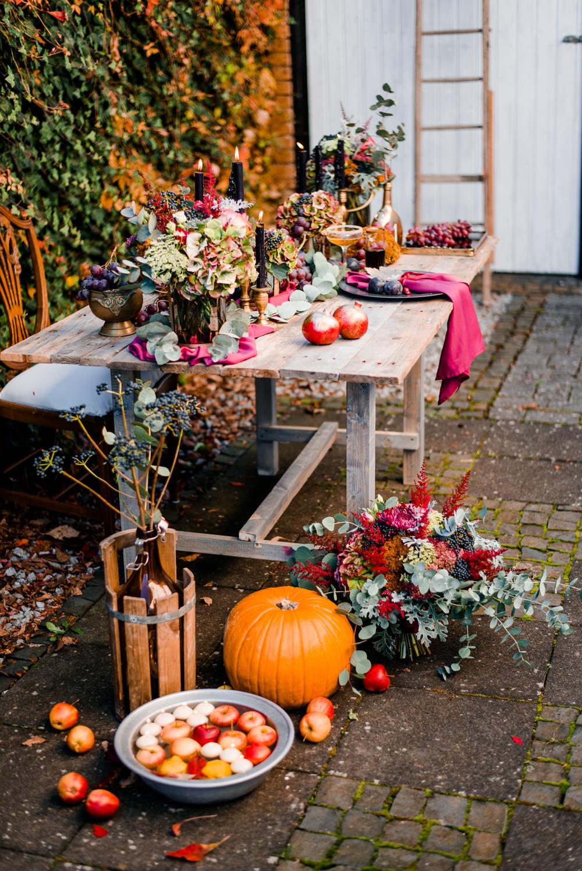Table Tablescape Decor Decoration Fruit Flowers Candles Autumn Pumpkins Autumnal Fairytale Wedding Ideas Miriam Peuser Photography