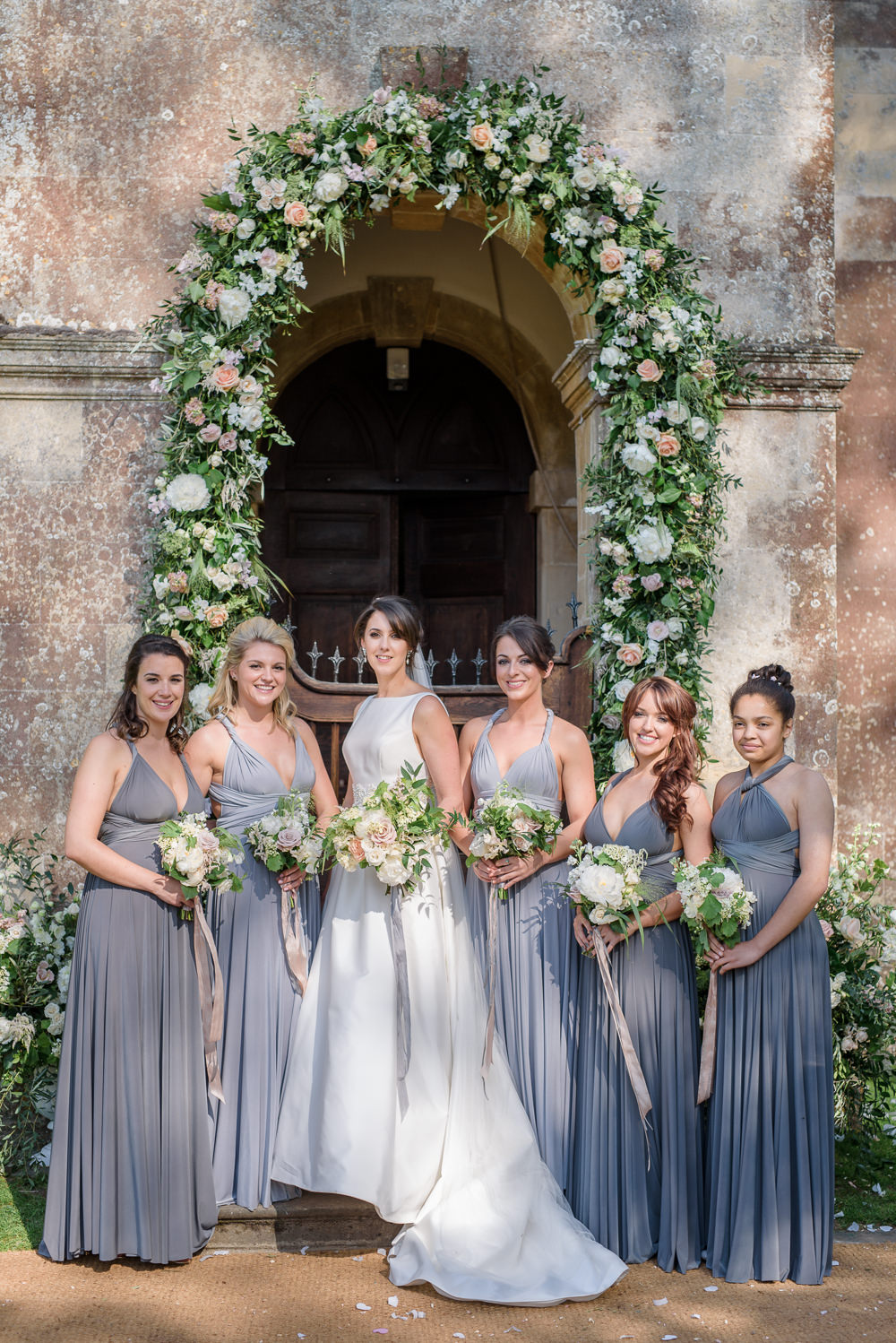 Bride Bridal A Line Dress Straps Sleeveless Silk Boat Neck Veil Entrance Archway Floral Flowers Bouquet Silk Ribbon Bridesmaids Multiway Grey Platinum Babington House Wedding Ria Mishaal Photography