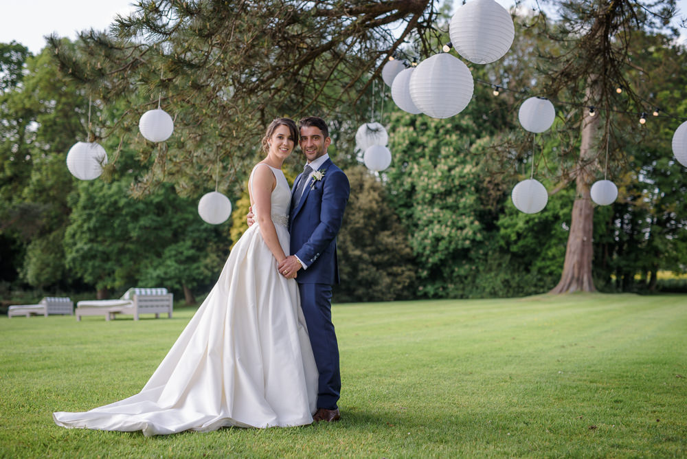 Bride Bridal A Line Dress Straps Sleeveless Silk Boat Neck Blue Suit Groom White Paper Lanterns Babington House Wedding Ria Mishaal Photography