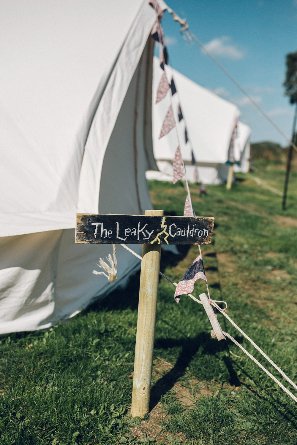 Glamping Bell Tents Sign Post Bright Camp Festival Wedding Chloe Lee Photography