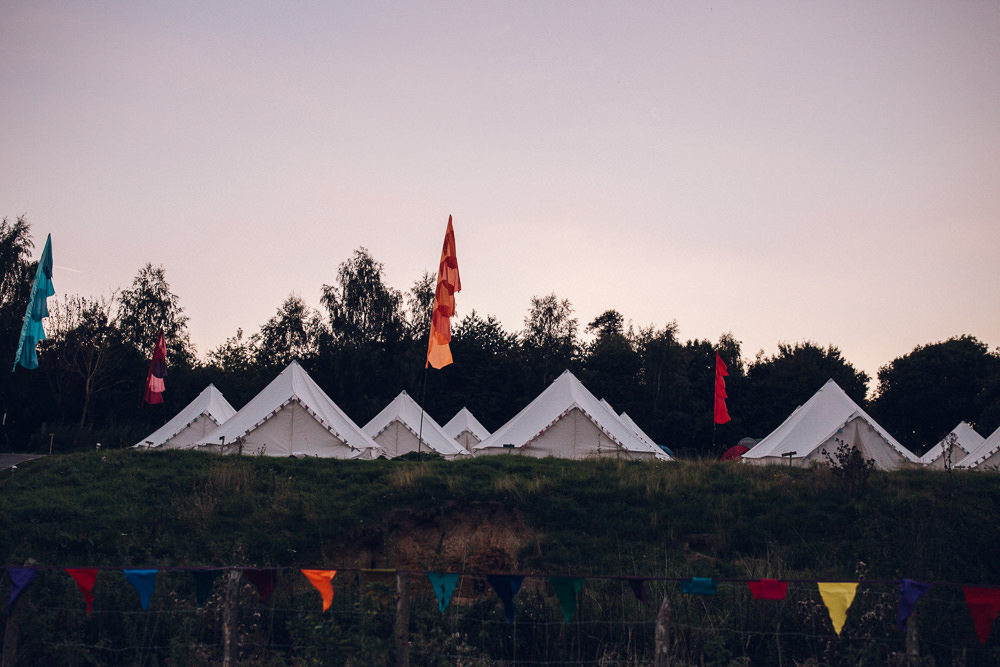 Glaping Bell Tents Flags Festival Bright Camp Festival Wedding Chloe Lee Photography