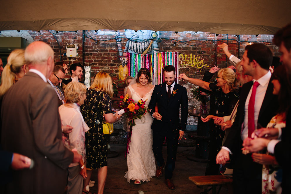 Bride Bridal Watters Lace Sleeveless Dress Gown Navy Suit Groom Colourful Multicoloured Bouquet Ribbon Backdrop Constellations Liverpool Wedding Dan Hough Photo