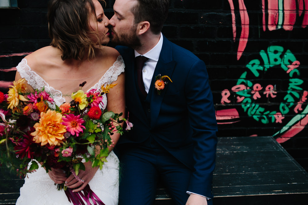 Bride Bridal Watters Lace Sleeveless Dress Gown Navy Suit Groom Colourful Multicoloured Bouquet Ribbon Constellations Liverpool Wedding Dan Hough Photo